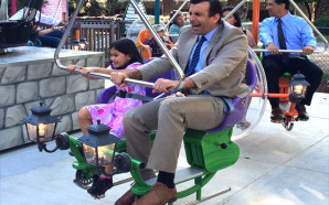 Mayor Sam Liccardo and a young guest at the grand unveiling of Happy Hollow Park & Zoo's newest ride, Dragon Flyers. Photo Courtesy: Happy Hollow Park & Zoo