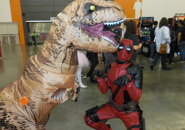 A T-Rex and Marvel character Deadpool pose together as part of the eclectic crowds that show up at FanimeCon. Photo Credit: Eduardo Hilario