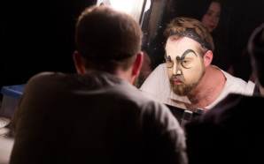 Quinto Ott doing his makeup for his character Don Attilio.