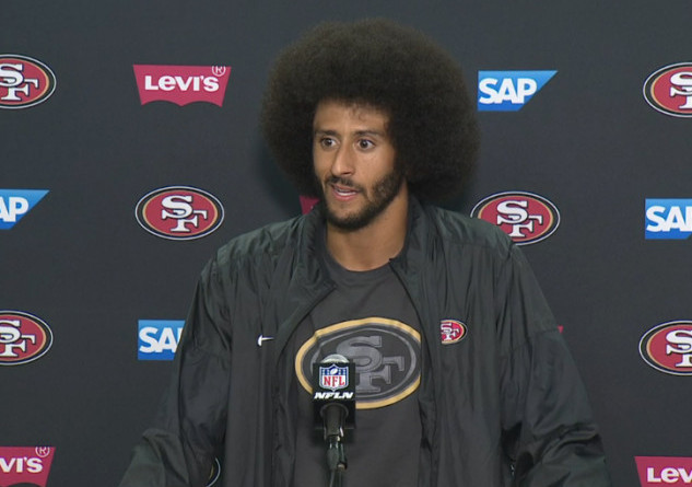 49ERS' COLIN KAEPERNICK HAS SPARKED THE SOCIAL JUSTICE CONVERSATION HE WANTED BY SITTING THROUGH THE NATIONAL ANTHEM