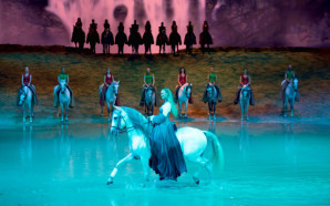 Rider Elise Verdoncq (center) with some of the 65 horses and 48 artists 