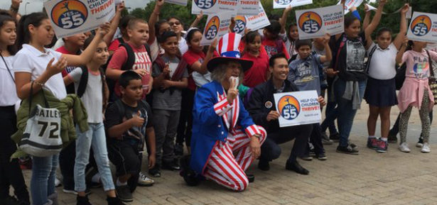 Dressed as Uncle Sam, Andrew Tonkovich, a lecturer in writing, poses with schoolchildren and Mayor Bao Nguyen of Garden Grove at a Prop 55 event at UC-Irvine on Monday October 17, 2016. (Fred Glass/California Federation of Teachers)