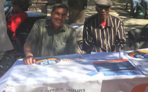 Ed Jaramillo, left, president of the Peralta Federation of Teachers, and Al Young, right, manned a table at a Prop. 55 event at Laney College in Oakland on Tuesday. (Fred Glass/Calif. Federation of Teachers)