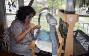 Consuelo Jimenez Underwood working on her weaving loom at her home in Cupertino. Photo Credit: Estephany Haro