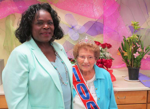 Colleen Hudgen, Executive Director at Live Oak Adult Day Services, seen here at Irene Cusimano's 100th birthday celebration.