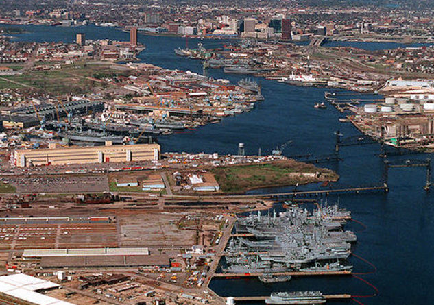 A warming climate and rising sea levels already are affecting U.S. military bases. Photo Credit: Robert J. Sitar, USN/Wikimedia Commons