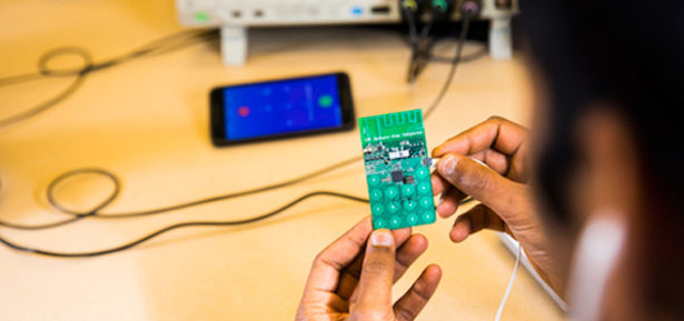 The prototype for a battery-free cell phone developed at the University of Washington was built with cheap, off-the-shelf components. Photo Credit: Mark Stone/University of Washington