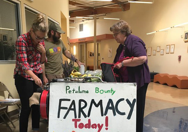 """The """"Farmacy"""" at the Petaluma Health Center sells produce at deep discounts to low-income families as part of its mission to encourage better health. Photo Credit: Petaluma Health Center"""