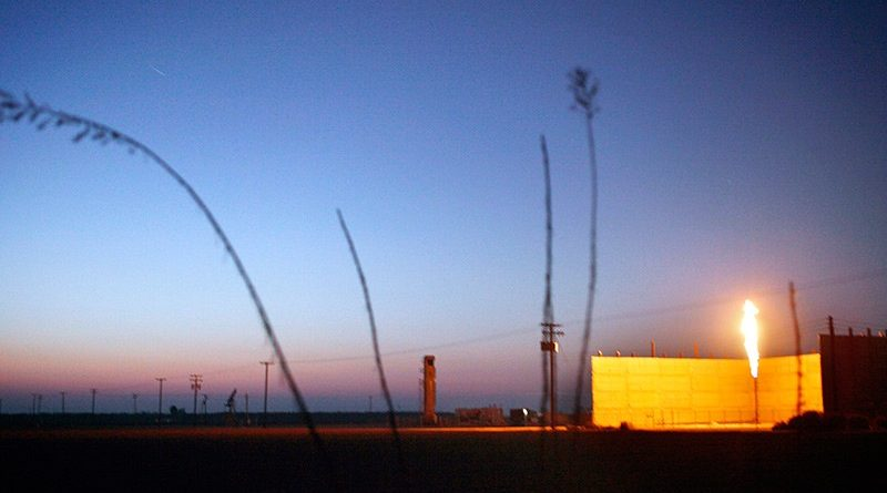 Gas flares at a well in Bakersfield, Calif. Photo Credit: Chris Jordan-Bloch/Earthjustice